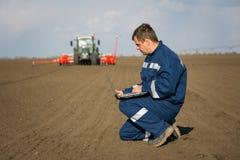 Farmer calculate Royalty Free Stock Photo