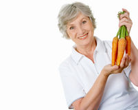 Farmer with carrots Stock Photos