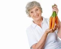 Farmer with carrots Stock Photos