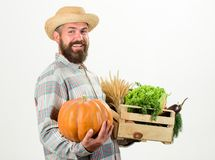 Farmer carry box or basket harvest vegetables. Excellent quality vegetables. Grocery shop concept. Delivery service. Fresh vegetables from farm. Buy fresh stock photography