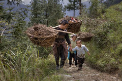 Farmer Carrying Bamboo Baskets on His Shoulders Royalty Free Stock Image