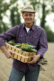 Farmer carrying  a crate of vegetables Royalty Free Stock Photo