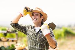 Farmer carrying shovel Stock Photography