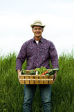 Farmer carrying vegetables Stock Photos