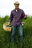 Farmer carrying vegetables Royalty Free Stock Photography