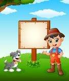 Farmer cartoon on farmland with blank sign Stock Photography