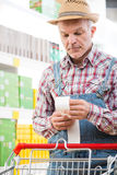 Farmer checking bills at supermarket Royalty Free Stock Photography