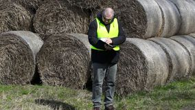 Farmer checking the hay bales stock video