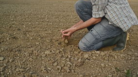 Farmer Checking Soil Quality of Fertile Agricultural Farm Land stock footage