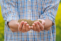 Farmer Checking Soil Quality of Fertile Agricultural Farm Land stock image