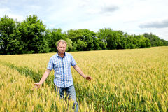 Farmer checking soybean field. The unique technology of growing. Crops. Farmer sitting in the field on a background of wheat and soybeans. Golf bread. Growing Stock Photography