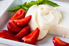 Farmer cheese and cream with strawberry compote topping Stock Image