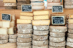 Farmer cheese on market counter. With price labels Stock Photos