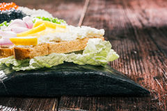 Farmer cheese sandwiches with various tops Royalty Free Stock Photos