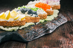 Farmer cheese sandwiches with various tops Royalty Free Stock Photo