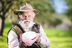 Farmer with cheese Stock Photos