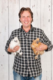 Farmer with chickens Royalty Free Stock Photo