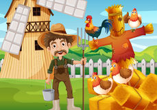 Farmer and chickens in the field Royalty Free Stock Photography