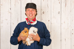 Farmer with chickens Stock Photo