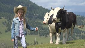 Farmer Child Pasturing Cows, Cowherd Kid with Cattle on Meadow Girl in Mountains.  stock photos