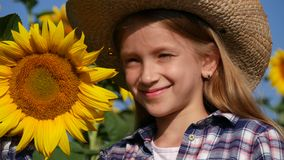 Farmer Child in Sunflower Field Happy Girl Playing Smiling Looking in Camera 4K.  stock footage