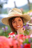 Farmer close up. Close up of an attractive young woman shopping for flowers at the farmers market Royalty Free Stock Photo