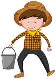 Farmer. Close up farmer holding a bucket Stock Image