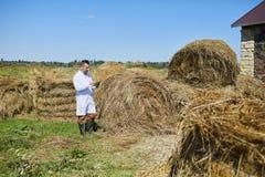 Farmer of contemporary kettlefarm Stock Photos
