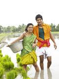 Farmer couple working in a paddy field. Asian farmer couple working in a paddy field Royalty Free Stock Photo