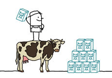 Farmer & cow producing milk Stock Image