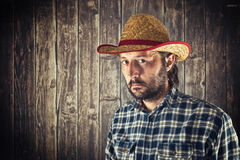 Farmer with cowboy straw hat Royalty Free Stock Images