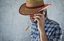Farmer with cowboy straw hat Stock Images