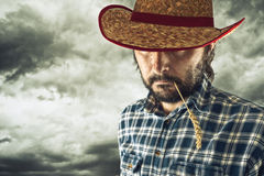 Farmer with cowboy straw hat Royalty Free Stock Photo