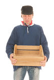 Farmer with crate isolated over white background Royalty Free Stock Image