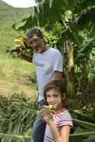 Farmer and daughter in banana plantation Royalty Free Stock Photos