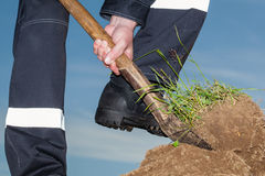 Farmer digging a garden Royalty Free Stock Photos
