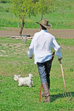 Farmer and dog Royalty Free Stock Photos