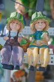 Farmer dolls sitting on white chair. royalty free stock image