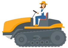 Farmer driving catepillar tractor Stock Photo