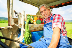 Farmer Driving His Tractor Royalty Free Stock Photography