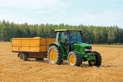 Farmer Driving John Deere 5820 Tractor and Trailer Stock Photo