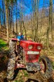 Farmer driving a old tractor Royalty Free Stock Photography