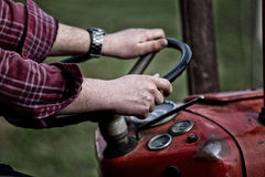 Farmer driving tractor Royalty Free Stock Image