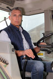 Farmer driving tractor Stock Image