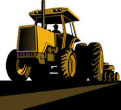 Farmer driving vintage tractor Royalty Free Stock Images