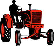 Farmer driving vintage tractor Stock Photo