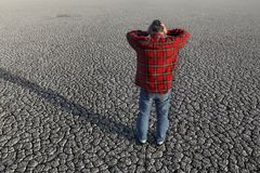 Farmer and drought in field. Desperate man holding his head in his hands at dry cracked land after drought, natural disaster Stock Photography