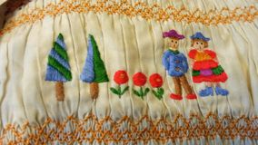 Farmer family colorful folk  embroidery and smock Royalty Free Stock Photography