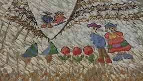 Farmer family colourful  embroidery Stock Photo