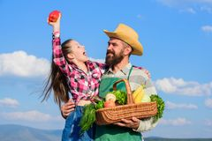 Farmer family homegrown harvest. Only organic and fresh harvest. Father and daughter hold basket harvest vegetables. Gardening and harvesting. Family farm stock photography